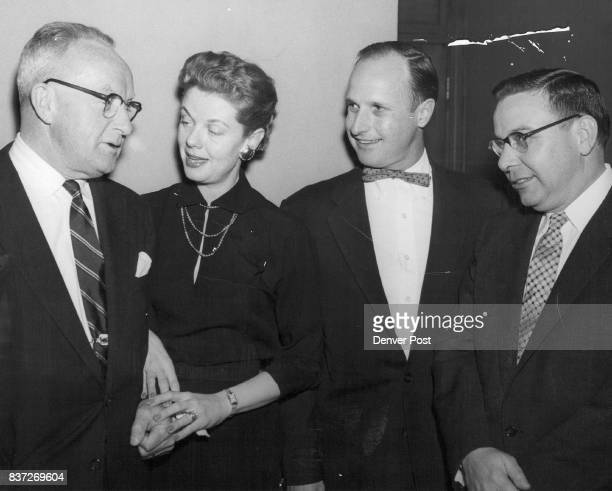 Frank J Healy lighting vice president for Sylvania Electric Products Co and B K Wickstrum Sylvania confer with Mr and Mrs John C Davis III of the...