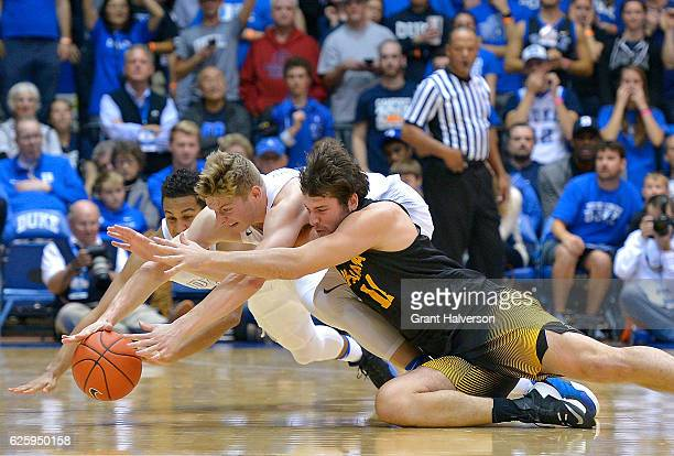 Frank Jackson and Jack White of the Duke Blue Devils battle Emarius Logan of the Appalachian State Mountaineers for a loose ball during the game at...