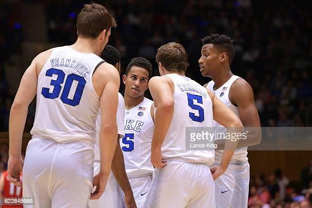 Frank Jackson listens while huddling with Antonio Vrankovic Matt Jones Luke Kennard and Javin DeLaurier of the Duke Blue Devils during their game...