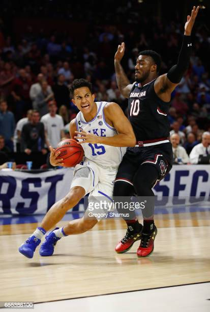 Frank Jackson of the Duke Blue Devils drives against Duane Notice of the South Carolina Gamecocks in the second half during the second round of the...