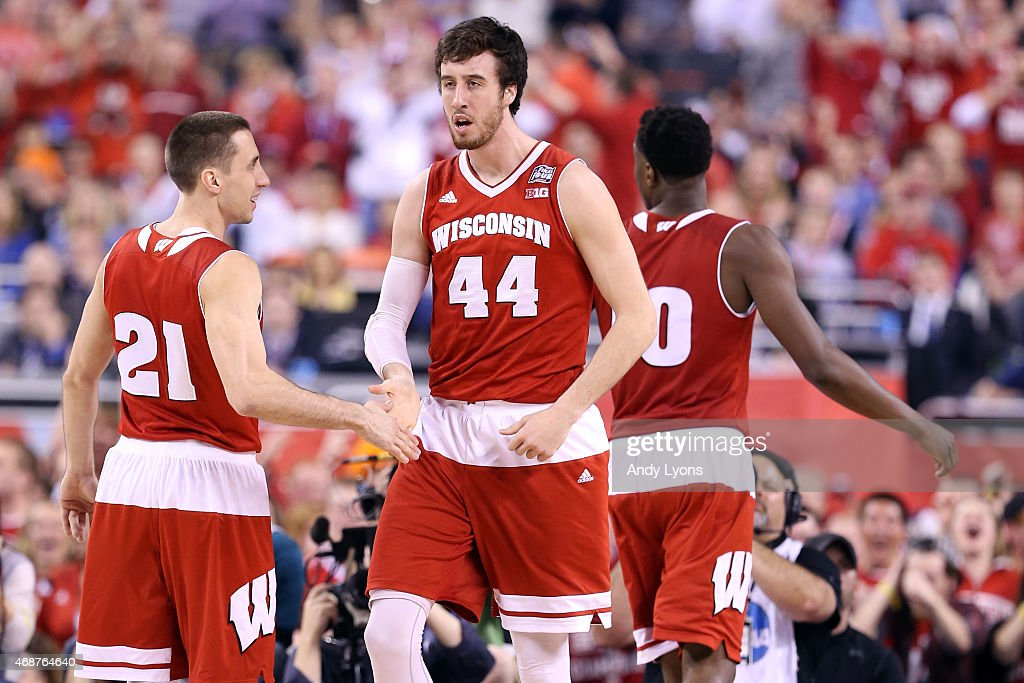 <a gi-track='captionPersonalityLinkClicked' href=/galleries/search?phrase=Frank+Kaminsky&family=editorial&specificpeople=8685398 ng-click='$event.stopPropagation()'>Frank Kaminsky</a> #44 and <a gi-track='captionPersonalityLinkClicked' href=/galleries/search?phrase=Josh+Gasser&family=editorial&specificpeople=7355332 ng-click='$event.stopPropagation()'>Josh Gasser</a> #21 of the Wisconsin Badgers react after a play in the first half against the Duke Blue Devils during the NCAA Men's Final Four National Championship at Lucas Oil Stadium on April 6, 2015 in Indianapolis, Indiana.