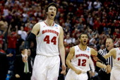 Frank Kaminsky and Traevon Jackson of the Wisconsin Badgers celebrate defeating the Oregon Ducks during the third round of the 2014 NCAA Men's...