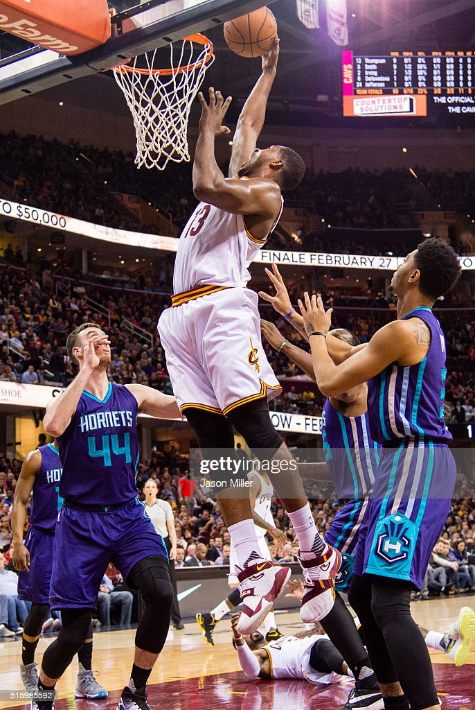 Frank Kaminsky III and Jeremy Lamb of the Charlotte Hornets guard Tristan Thompson of the Cleveland Cavaliers during the first half at Quicken Loans...