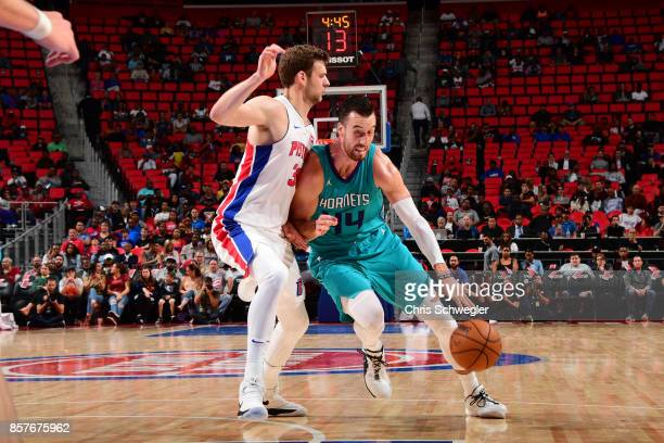 Frank Kaminsky of the Charlotte Hornets handles the ball against the Detroit Pistons during a preseason game on October 4 2017 at The Palace of...