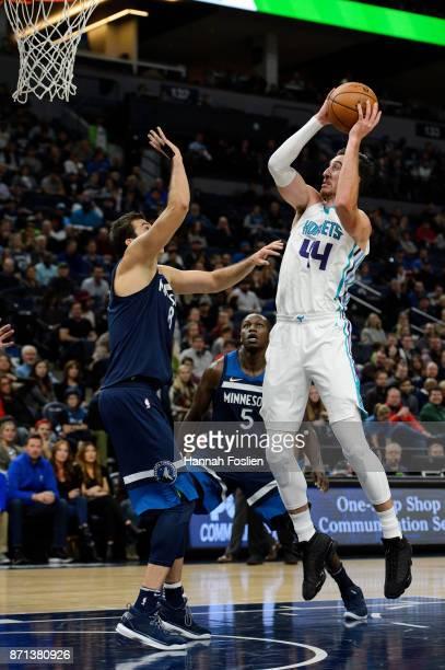 Frank Kaminsky of the Charlotte Hornets shoots the ball against Nemanja Bjelica of the Minnesota Timberwolves during the game on November 5 2017 at...