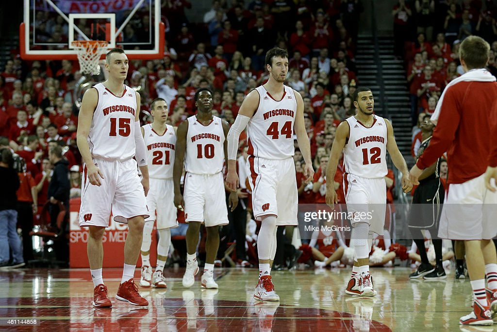 Frank Kaminsky of the Wisconsin Badgers along with Sam Dekker Traevon Jackson Nigel Hayes and Josh Gasser of the Purdue Boilermakers during the...