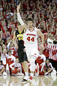 Frank Kaminsky of the Wisconsin Badgers celebrates after making a threepointer during the first half against the Iowa Hawkeyes at Kohl Center on...