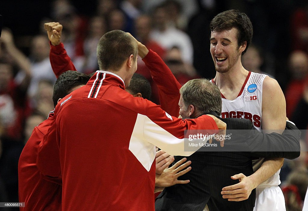 Frank Kaminsky of the Wisconsin Badgers celebrates with his team after defeating the Oregon Ducks during the third round of the 2014 NCAA Men's...