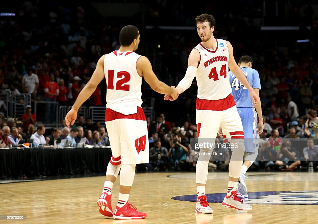 Frank Kaminsky of the Wisconsin Badgers celebrates with Traevon Jackson after the Badgers 7972 victory against the North Carolina Tar Heels during...
