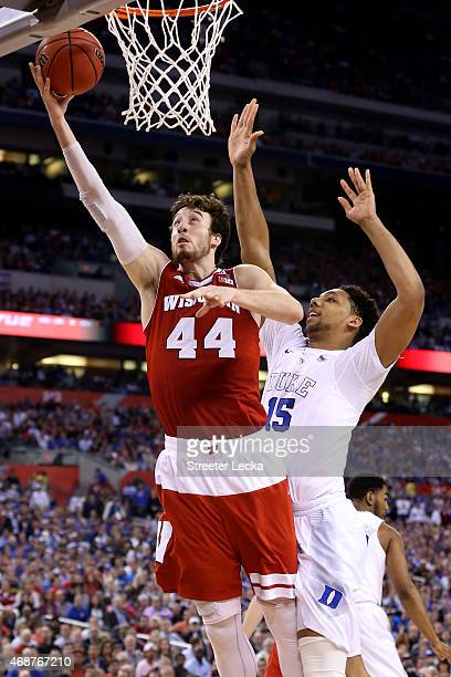 Frank Kaminsky of the Wisconsin Badgers drives to the basket against Jahlil Okafor of the Duke Blue Devils in the second half during the NCAA Men's...