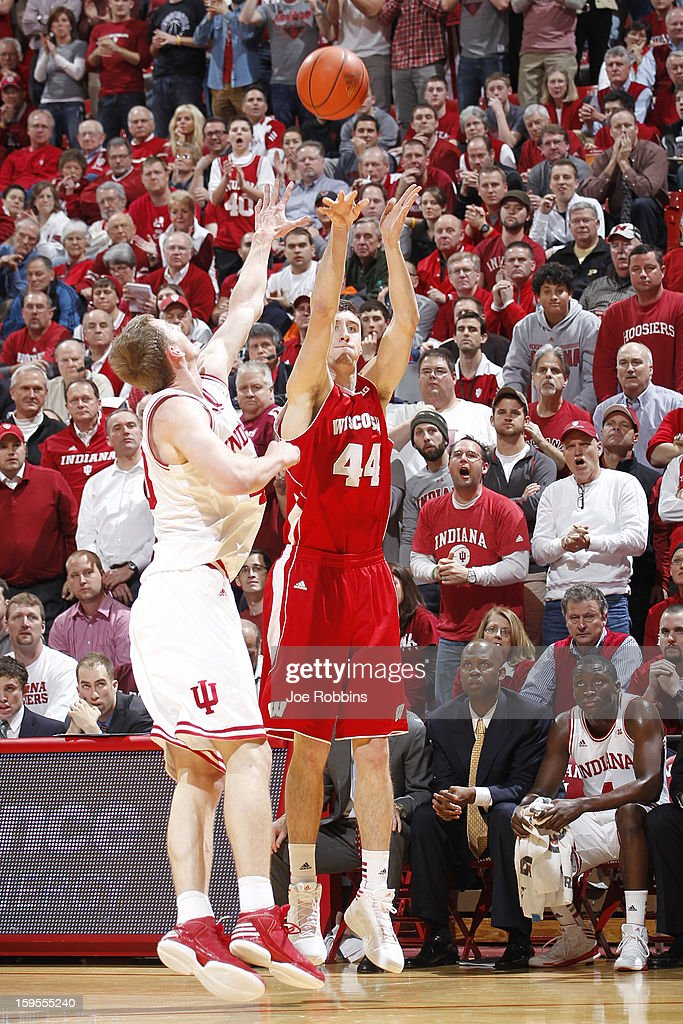 Frank Kaminsky #44 of the Wisconsin Badgers hits a three-point shot over <a gi-track='captionPersonalityLinkClicked' href=/galleries/search?phrase=Cody+Zeller&family=editorial&specificpeople=7621233 ng-click='$event.stopPropagation()'>Cody Zeller</a> #40 of the Indiana Hoosiers during the game at Assembly Hall on January 15, 2013 in Bloomington, Indiana. Wisconsin defeated Indiana 64-59.