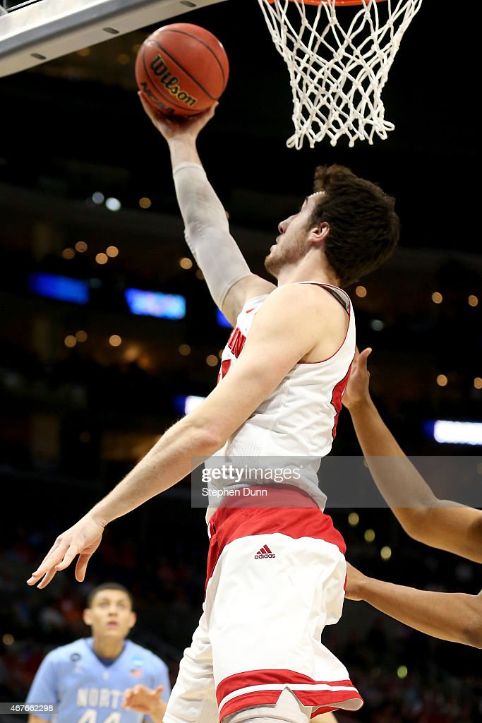 Frank Kaminsky of the Wisconsin Badgers shoots the ball from under the basket against the North Carolina Tar Heels during the West Regional Semifinal...