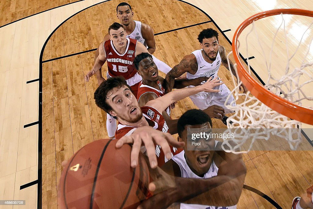 Frank Kaminsky of the Wisconsin Badgers tries to block Dakari Johnson of the Kentucky Wildcats in the first half during the NCAA Men's Final Four...
