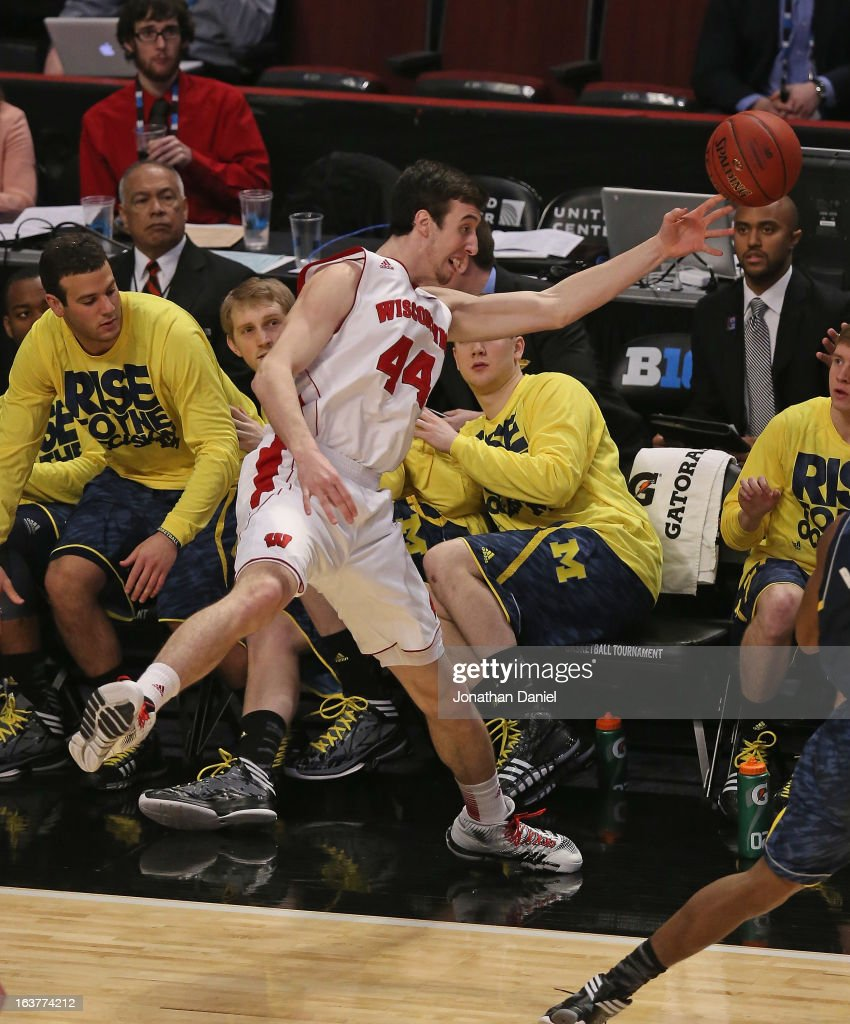 Frank Kaminsky #44 of the Wisconsin Badgers tries to save the ball from going out of bounds in front of the Michigan Wolverine bench during a quarterfinal game of the Big Ten Basketball Tournament at the United Center on March 15, 2013 in Chicago, Illinois.