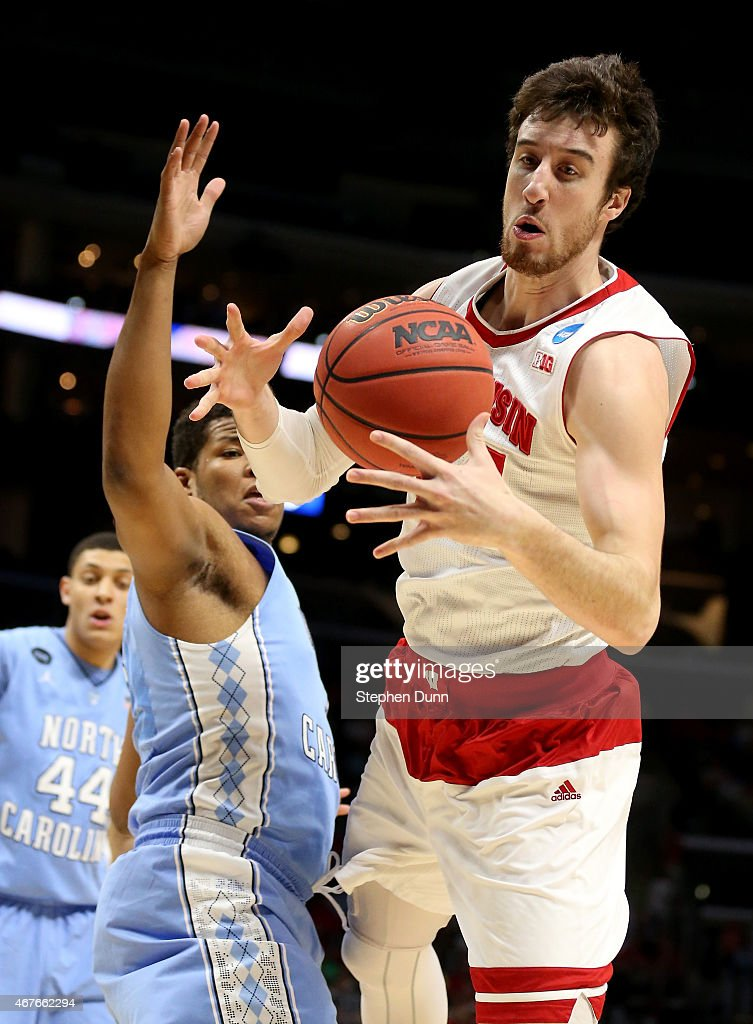 Frank Kaminsky of the Wisconsin Badgers with the ball against Kennedy Meeks of the North Carolina Tar Heels in the first half during the West...