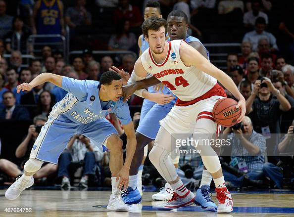 Frank Kaminsky of the Wisconsin Badgers with the ball against Marcus Paige of the North Carolina Tar Heels in the first half during the West Regional...