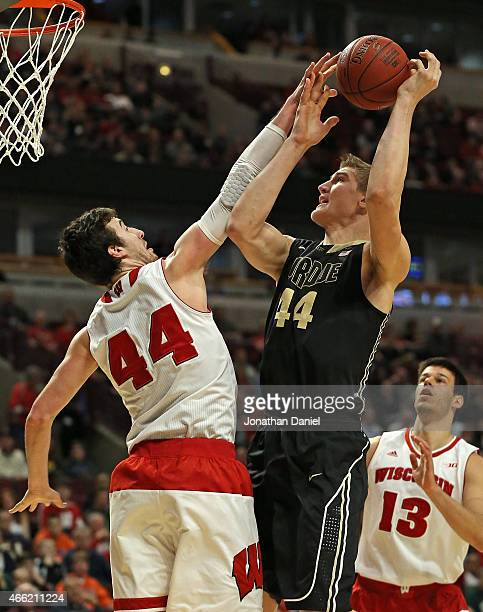 Frank Kaminsky#44 of the Wisconsin Badgers blocks a shot by Isaac Haas of the Purdue Boilermakers during the semifinal round of the 2015 Big Ten...