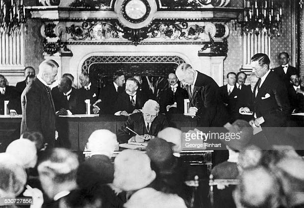 Frank Kellogg Secretary of State for the United States signs the KelloggBriand Pact in the Clock Salon in Paris