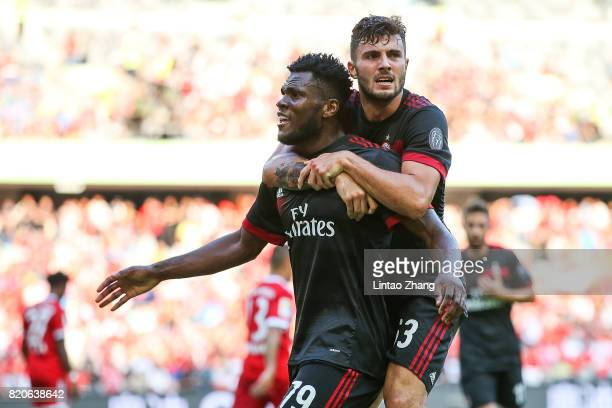 Frank Kessie celebrates a goal with teammate Patrick Cutrone during the 2017 International Champions Cup China match between FC Bayern and AC Milan...