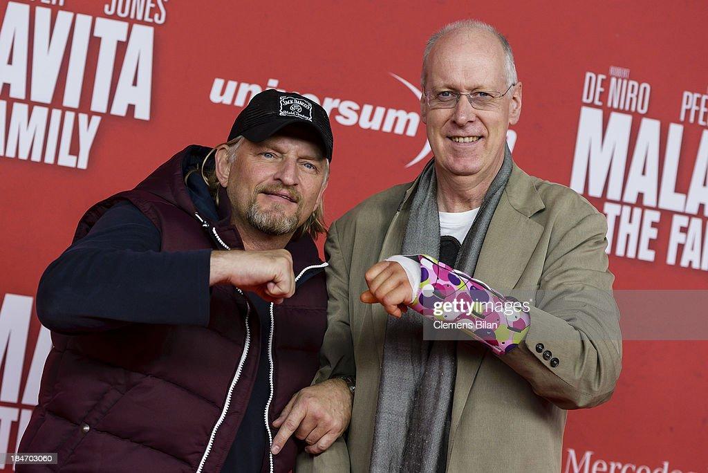 Frank Kessler (L) and Gottfried Vollmer attend the 'Malavita' premiere at Kino in der Kulturbrauerei on October 15, 2013 in Berlin, Germany.