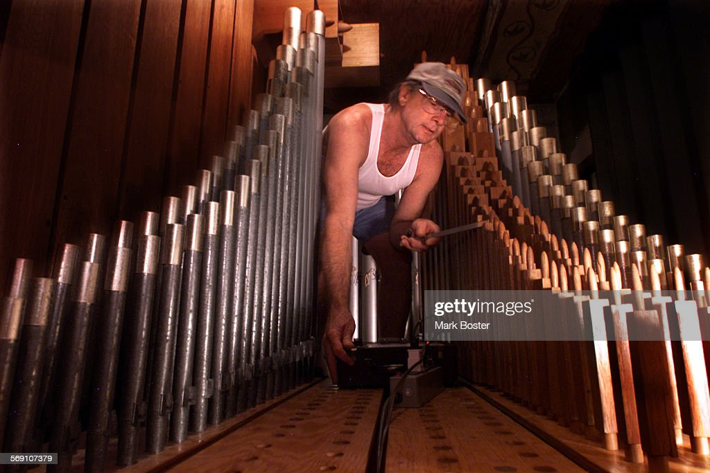 Frank Kieran tuned the pipes connected to the vintage organ in the Serra Chapel at Mission San Juan Capistrano with an electronic tuner and his ear...