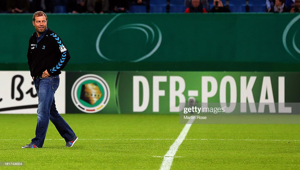 Frank Kramer, head coach of Greuther Fuerth reacts before the DFB Cup second round match between Hamburger SV and Greuther Fuerth at Imtech Arena on September 24, 2013 in Hamburg, Germany.