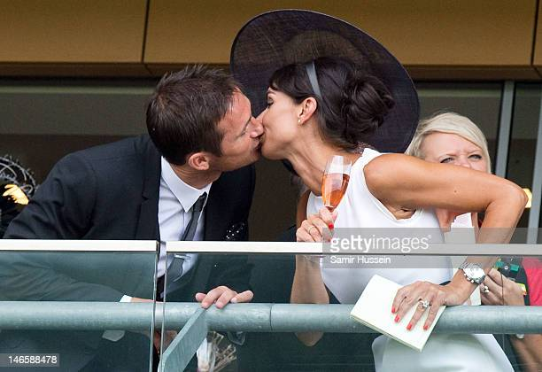 Frank Lampard and Christine Bleakley kiss on the baloncy on day 2 of Royal Ascot 2012 at Ascot Racecourse on June 20 2012 in Ascot United Kingdom