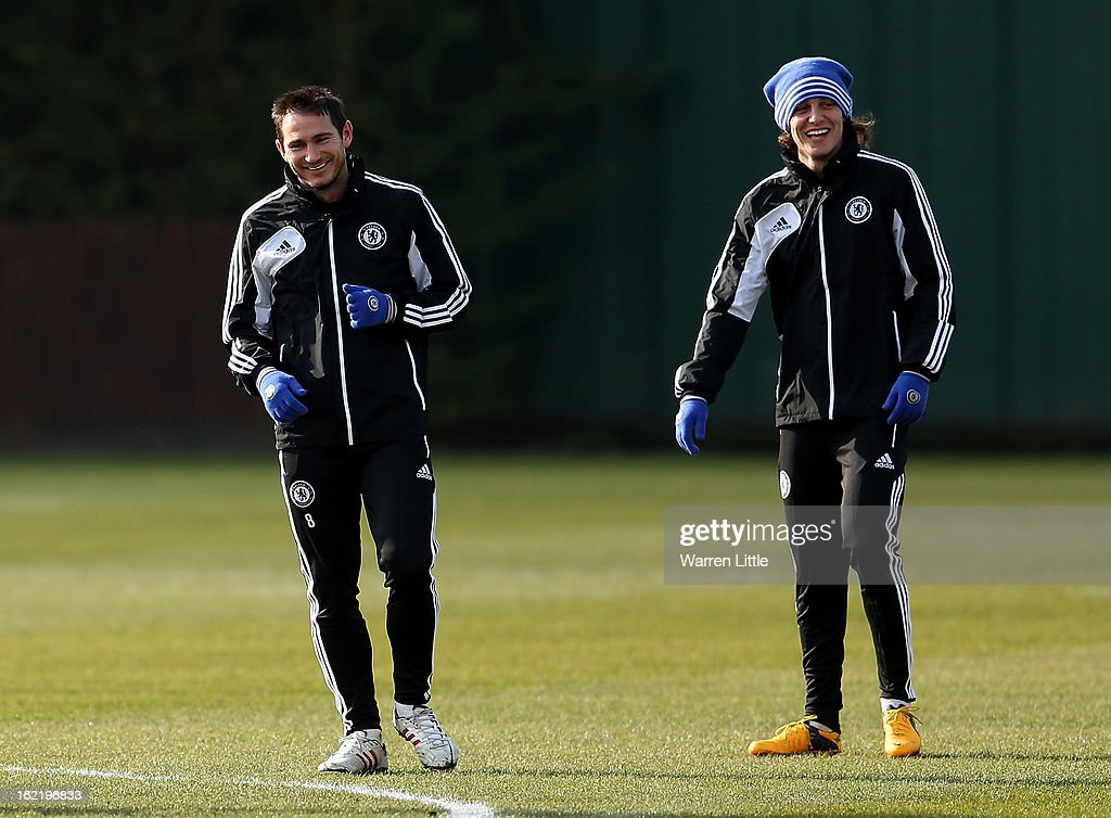 Frank Lampard and David Luiz of Chelsea share a joke during a training session at Cobham training ground on February 20, 2013 in Cobham, England.