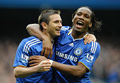 Frank Lampard and Didier Drogba of Chelsea celebrate their team's third goal scored by Lampard during the Barclays Premier League match between...