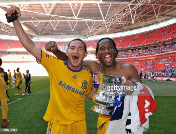 Frank Lampard and Didier Drogba of Chelsea celebrate with the trophy after the FA Cup sponsored by EON Final match between Chelsea and Everton at...
