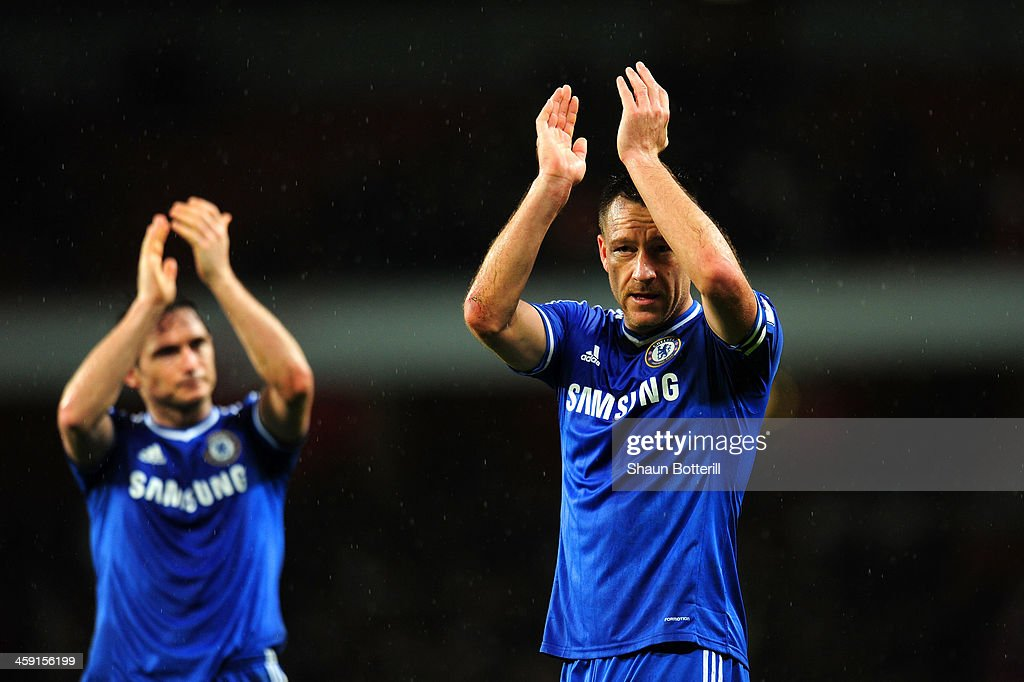 Frank Lampard and John Terry of Chelsea applaud the fans at the final whistle during the Barclays Premier League match between Arsenal and Chelsea at Emirates Stadium on December 23, 2013 in London, England.