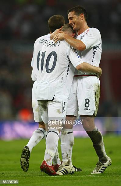 Frank Lampard and Wayne Rooney of England celebrate as Alexandr Kuchma of Kazakhstan scores an own goal during the 2010 World Cup qualifying match...