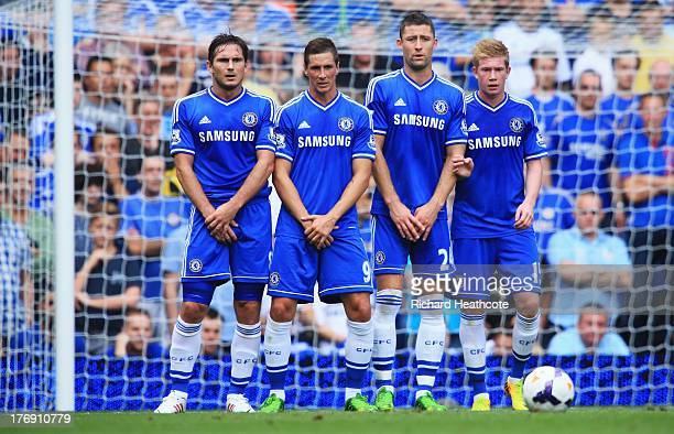 Frank Lampard Fernando Torres Gary Cahill and Kevin De Bruyne of Chelsea stand in the wall during the Barclays Premier League match between Chelsea...