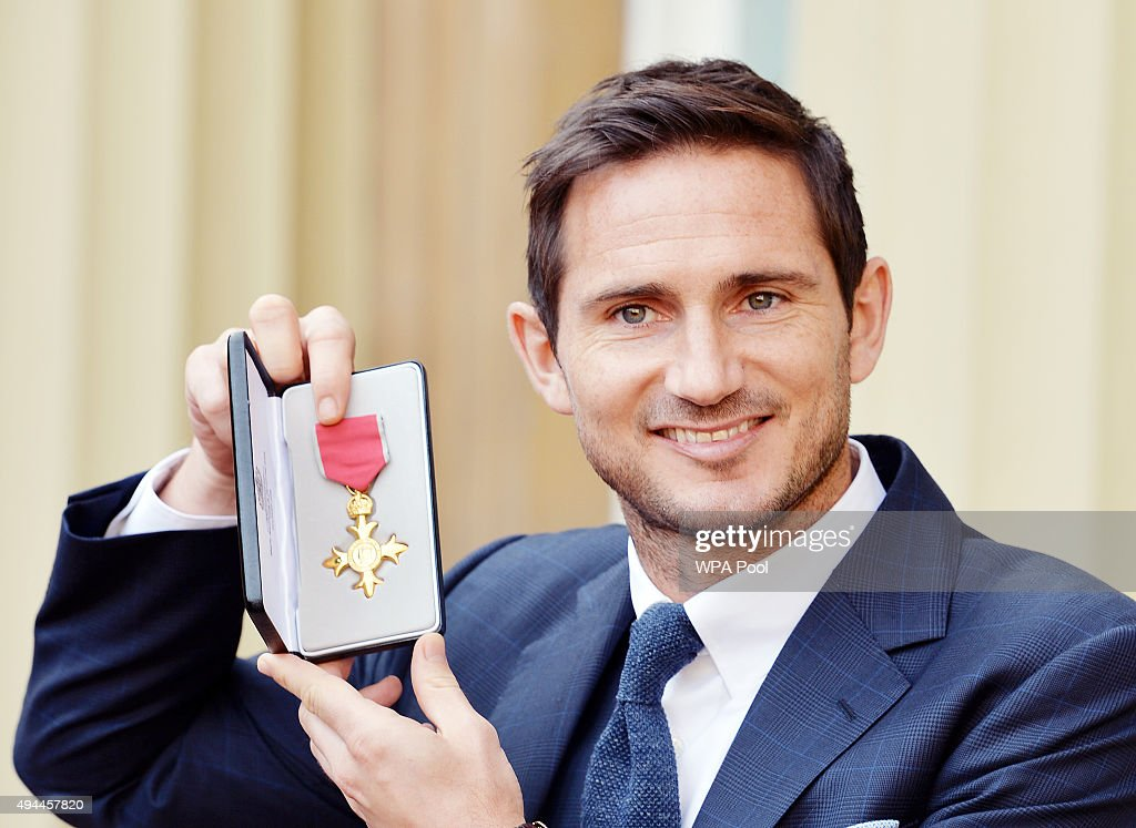 Frank Lampard holds his Officer of Order of the British Empire medal after it was presented to him by the Duke of Cambridge at an Investiture...