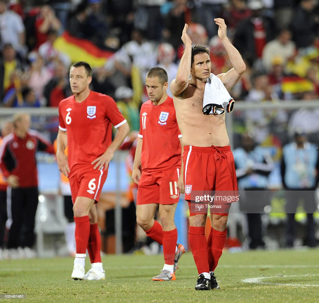 Frank Lampard (R), John Terry #6 and Joe Cole #11 of England react after the finish of the 2010 FIFA World Cup South Africa Round of Sixteen match between Germany and England at Free State Stadium on June 27, 2010 in Bloemfontein, South Africa. Germany won the match 4-1.