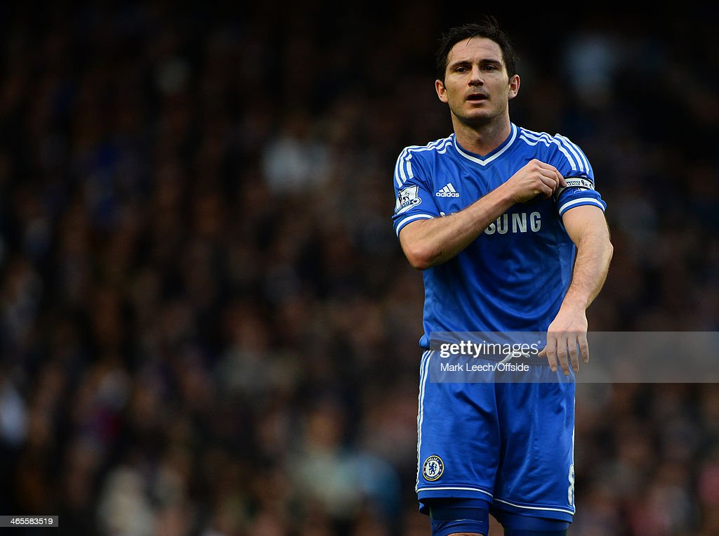 Frank Lampard of Chelsea adjusts the Captains armband during the FA Cup Fourth Round match between Chelsea and Stoke City at Stamford Bridge on January 26, 2014 in London, England.