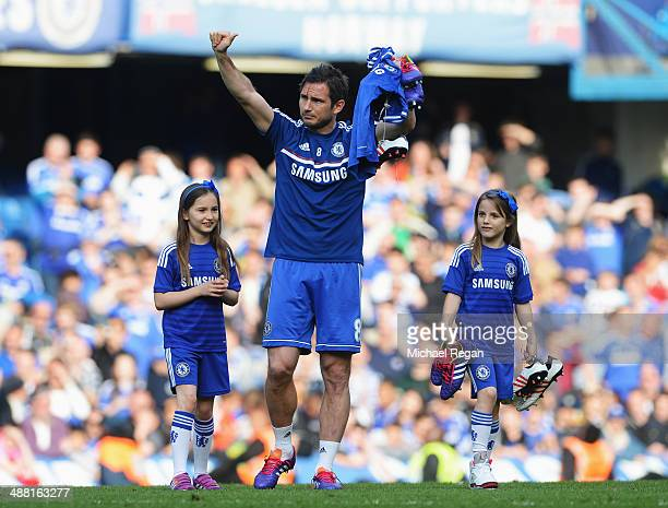 Frank Lampard of Chelsea and his daughters Luna and Isla appear on the pitch following the Barclays Premier League match between Chelsea and Norwich...