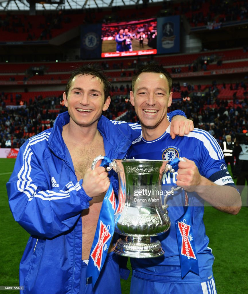 Frank Lampard of Chelsea and John Terry of Chelsea celebrate with the trophy after the FA Cup Final with Budweiser between Liverpool and Chelsea at Wembley Stadium on May 5, 2012 in London, England.