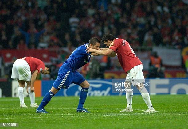 Frank Lampard of Chelsea and Owen Hargreaves of Manchester United help each other to stretch to avoid cramp during the UEFA Champions League Final...