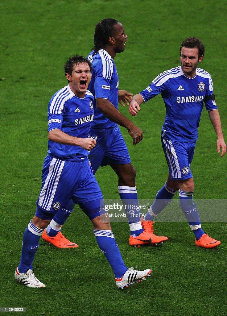 Frank Lampard of Chelsea (L) celebrates scoring from a free kick with team mates <a gi-track='captionPersonalityLinkClicked' href=/galleries/search?phrase=Didier+Drogba&family=editorial&specificpeople=179398 ng-click='$event.stopPropagation()'>Didier Drogba</a> (C) and <a gi-track='captionPersonalityLinkClicked' href=/galleries/search?phrase=Juan+Mata&family=editorial&specificpeople=4784696 ng-click='$event.stopPropagation()'>Juan Mata</a> during the FA Cup with Budweiser Semi Final match between Tottenham Hotspur and Chelsea at Wembley Stadium on April 15, 2012 in London, England.