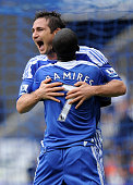 Frank Lampard of Chelsea celebrates scoring his team's fourth goal with Ramires during the Barclays Premier League match between Bolton Wanderers and...