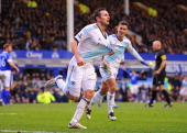 Frank Lampard of Chelsea celebrates scoring his team's second goal to make the score 12 during the Barclays Premier League match between Everton and...
