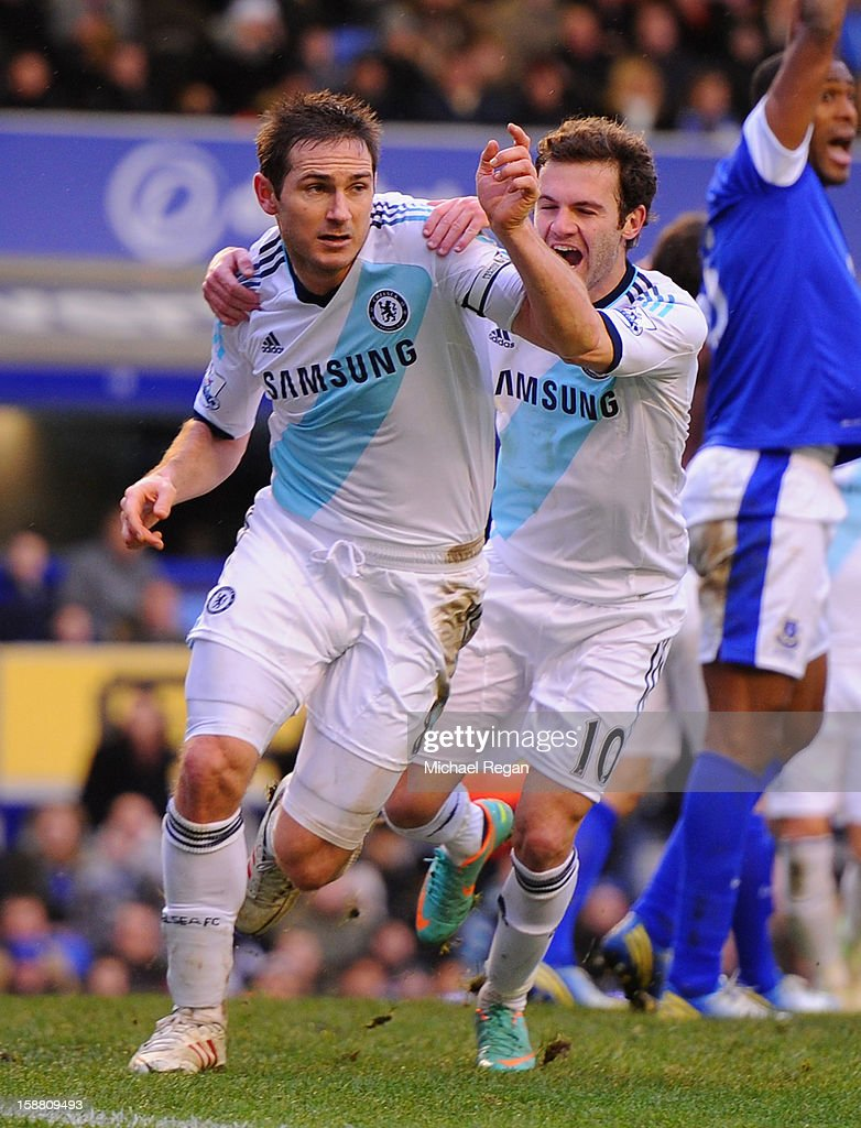 Frank Lampard (L) of Chelsea celebrates scoring his team's second goal to make the score 1-2 during the Barclays Premier League match between Everton and Chelsea at Goodison Park on December 30, 2012 in Liverpool, England.