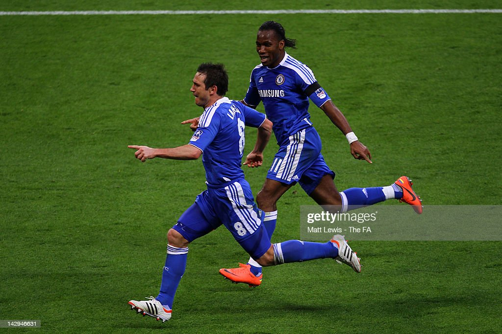 Frank Lampard of Chelsea celebrates scoring their fourth goal with <a gi-track='captionPersonalityLinkClicked' href=/galleries/search?phrase=Didier+Drogba&family=editorial&specificpeople=179398 ng-click='$event.stopPropagation()'>Didier Drogba</a> during the FA Cup with Budweiser Semi Final match between Tottenham Hotspur and Chelsea at Wembley Stadium on April 15, 2012 in London, England.