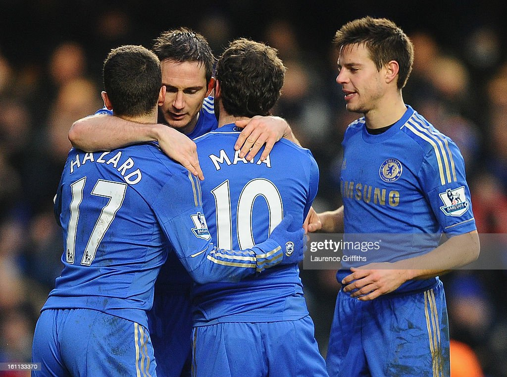 Frank Lampard of Chelsea celebrates the third goal with Eden Hazard and Juan Mata during the Barclays Premier League match between Chelsea and Wigan Athletic at Stamford Bridge on February 9, 2013 in London, England.