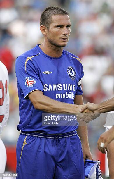 Frank Lampard of Chelsea FC shakes a hand prior to taking on AC Milan in their World Series of Football friendly match on July 24 2005 at Gillette...
