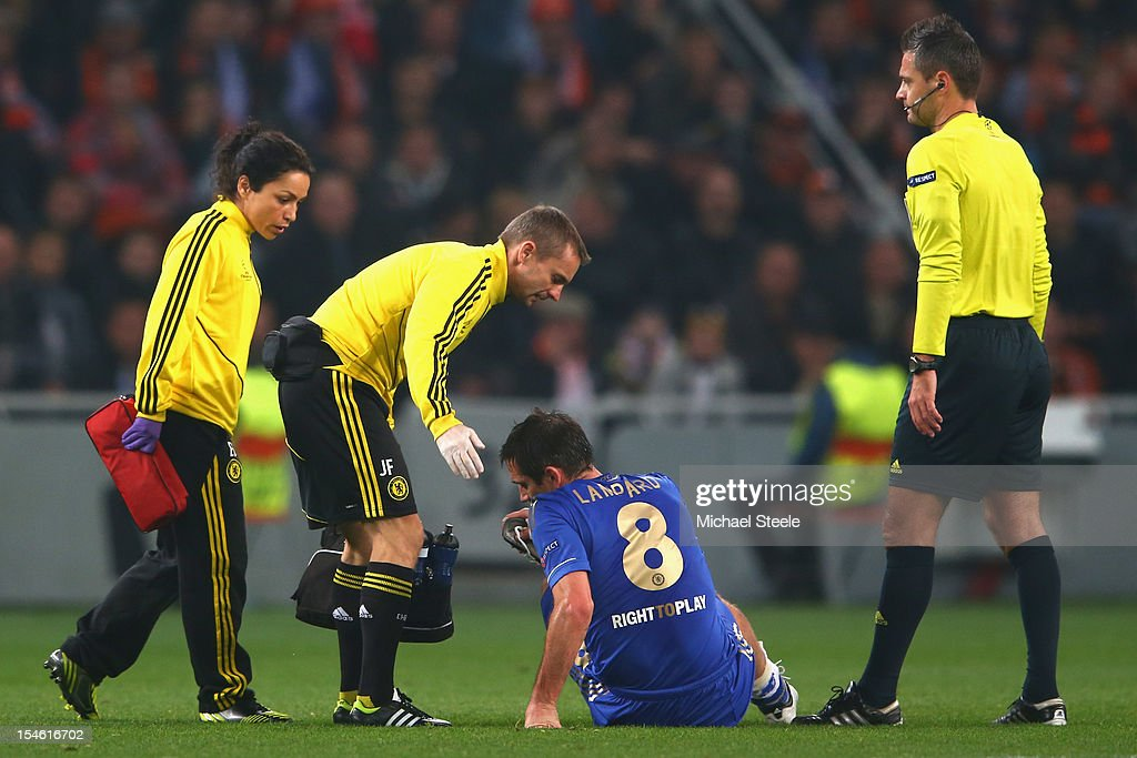 Frank Lampard of Chelsea goes down injured and is substituted during the UEFA Champions League Group E match between Shakhtar Donetsk and Chelsea at the Donbass Arena on October 23, 2012 in Donetsk, Ukraine.