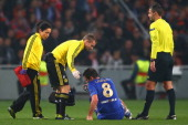 Frank Lampard of Chelsea goes down injured and is substituted during the UEFA Champions League Group E match between Shakhtar Donetsk and Chelsea at...