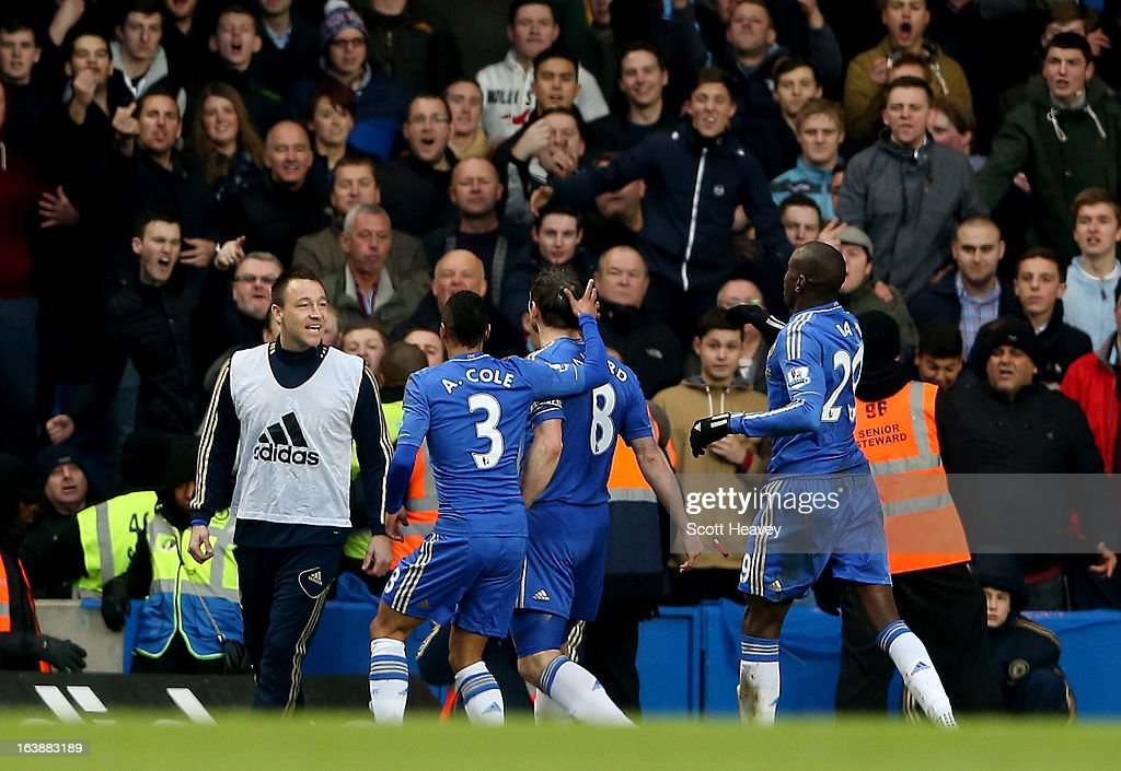 <a gi-track='captionPersonalityLinkClicked' href=/galleries/search?phrase=Frank+Lampard+-+Born+1978&family=editorial&specificpeople=11497645 ng-click='$event.stopPropagation()'>Frank Lampard</a> of Chelsea goes to celebrate with <a gi-track='captionPersonalityLinkClicked' href=/galleries/search?phrase=John+Terry&family=editorial&specificpeople=171535 ng-click='$event.stopPropagation()'>John Terry</a> after scoring their first goal during the Barclays Premier League match between Chelsea and West Ham United at Stamford Bridge on March 17, 2013 in London, England.