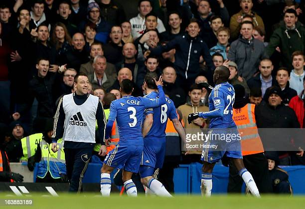 Frank Lampard of Chelsea goes to celebrate with John Terry after scoring their first goal during the Barclays Premier League match between Chelsea...